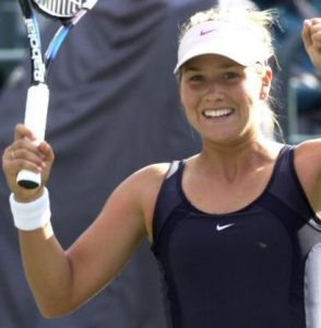 Ashley Harkleroad celebrates her win over Daniela Hantuchova of Slovakia during the quarterfinals of the Family Circle Cup on Friday, April 11, 2003, in Charleston, S.C. Harkleroad, a qualifier, upset fifth-seeded Hantuchova 6-2, 6-1. (AP Photo/Mary Ann Chastain)